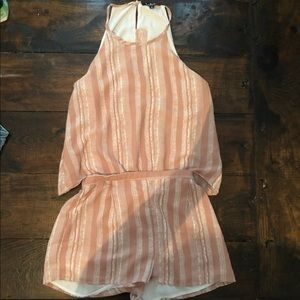 Playful romper with a button down back